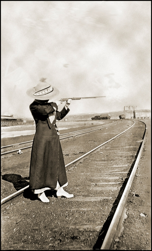 woman with gun on tracks