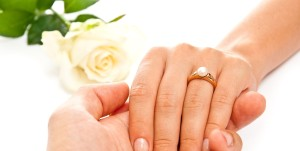 white background bride and groom hands