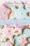 Cookies decorated with pink and blue snowflakes