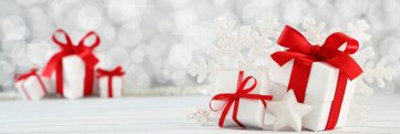 red bowed packages on white background