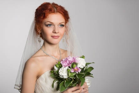 Charming bride with bouquet of flowers